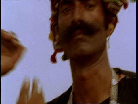 cu portrait of gujarat, indian man dancing, gujarat, india - 催眠状態点の映像素材/bロール