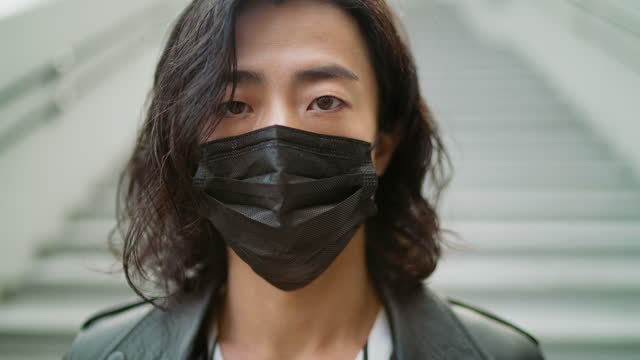 portrait of handsome fashionable young man with black protective face mask - handsome people stock videos & royalty-free footage