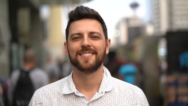 portrait of handsome man standing in the street - handsome people stock videos & royalty-free footage