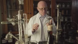 Portrait of handsome senior Caucasian man checking old-fashioned weighting machine, taking off eyeglasses and gesturing. Old apothecary working in vintage drugstore. 19th century, retro, ancient.