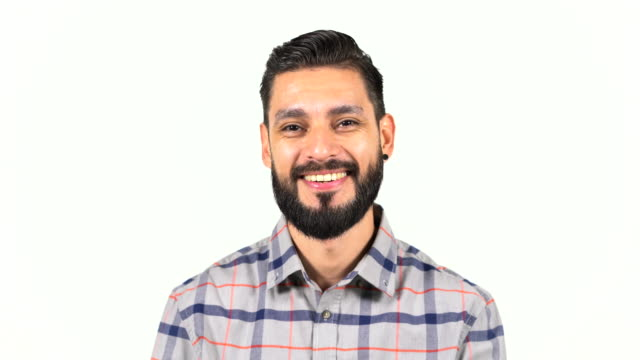 Portrait of handsome smiling bearded man in shirt