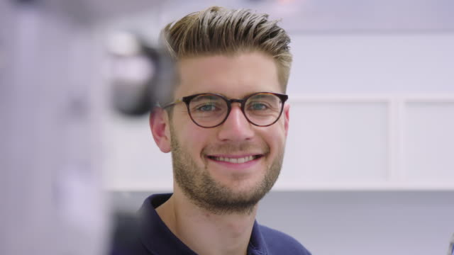 portrait of handsome smiling dentist at hospital - eyewear stock videos & royalty-free footage
