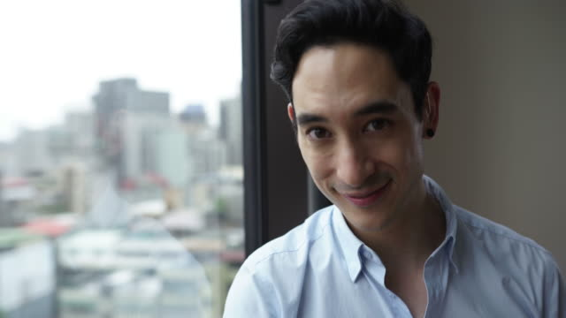 portrait of handsome young taiwanese man - hearing loss stock videos & royalty-free footage