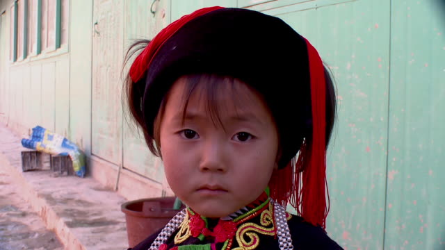 CU Portrait of Hani boy in traditional dress, Yuanyang, Yunnan, China