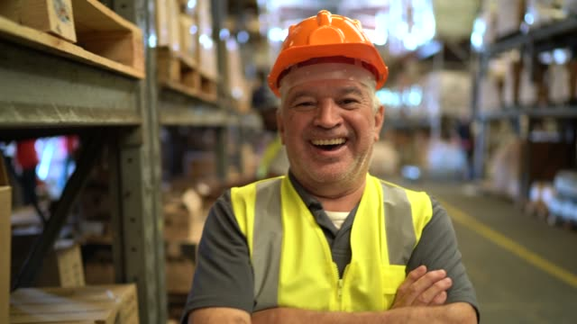 portrait of happy and smiling worker at warehouse - manufacturing occupation video stock e b–roll