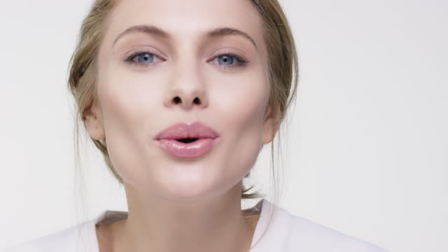 portrait of happy beautiful woman blowing kiss - lipstick stock videos & royalty-free footage