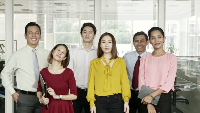 Portrait of happy business professionals at office