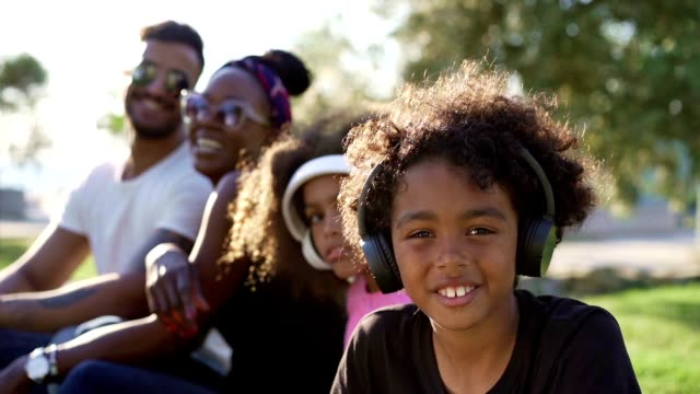 portrait of happy family in the park - young family stock videos & royalty-free footage