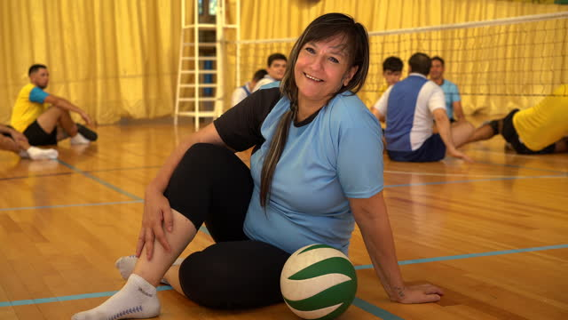 portrait of happy female volleyball coach at indoor court - sports team stock videos & royalty-free footage