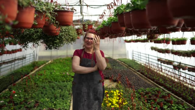 portrait of happy mature florist - greenhouse stock videos & royalty-free footage
