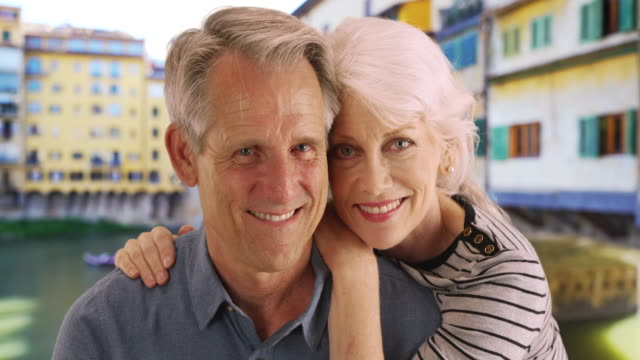 portrait of happy senior couple by the ponte vecchio bridge - ponte stock videos & royalty-free footage