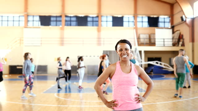 portrait of happy smiling young woman at gym - mid adult stock videos & royalty-free footage