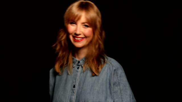 portrait of happy woman against black background - bangs stock videos and b-roll footage