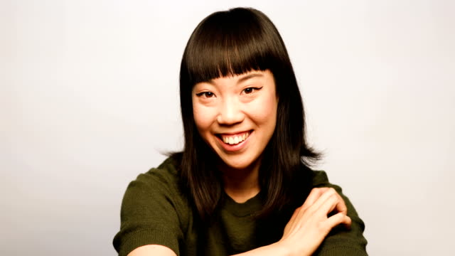 portrait of happy woman against white background - only japanese stock videos & royalty-free footage