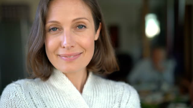 portrait of happy woman with family at home - offenes lächeln stock-videos und b-roll-filmmaterial
