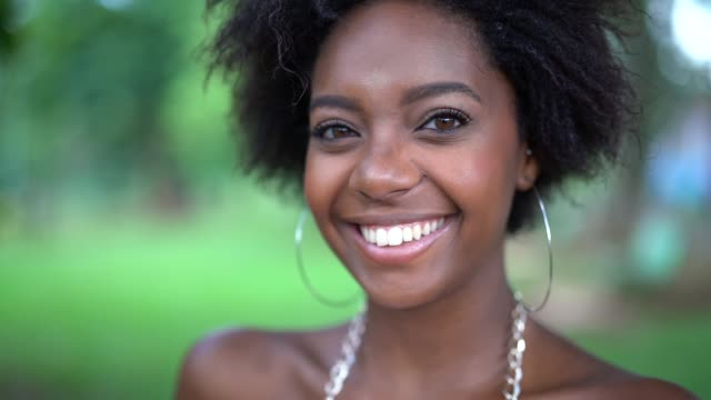 portrait of happy young afro woman - skin stock videos & royalty-free footage