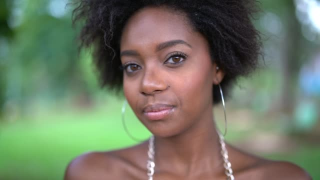 portrait of happy young afro woman - orecchini video stock e b–roll