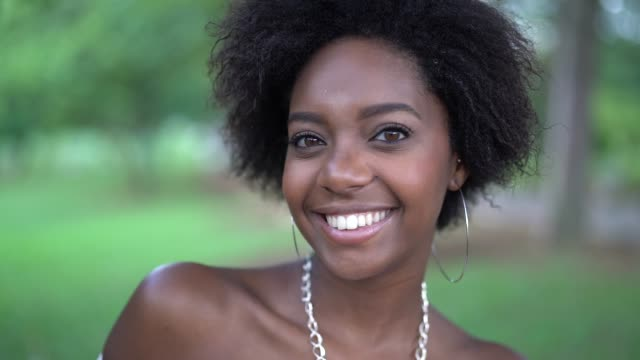portrait of happy young afro woman - ethiopia stock videos & royalty-free footage