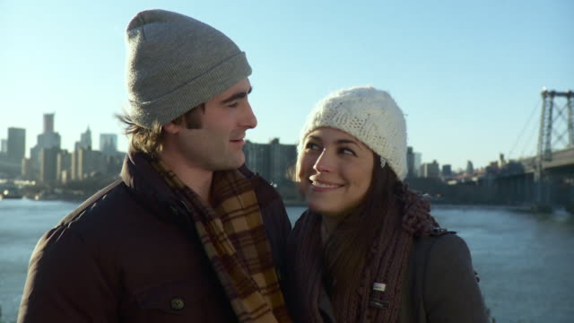 cu portrait of happy young couple with new york city skyline in background / new york, usa - see other clips from this shoot 1762 stock videos & royalty-free footage