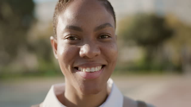 portrait of happy young woman in the city - video portrait stock videos & royalty-free footage
