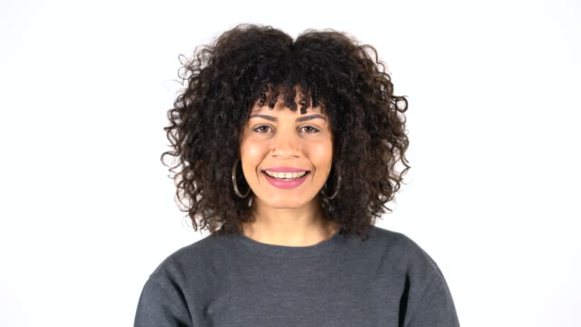 portrait of happy young woman with curly hair - white background stock videos & royalty-free footage