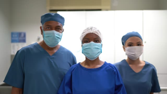 portrait of healthcare teamwork at hospital - nurse stock videos & royalty-free footage