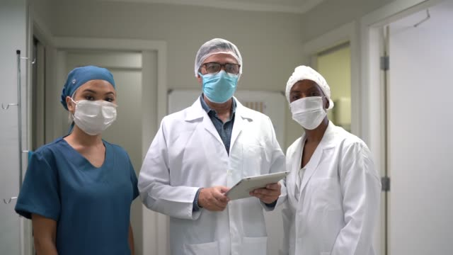 portrait of healthcare teamwork at hospital - looking at camera stock videos & royalty-free footage