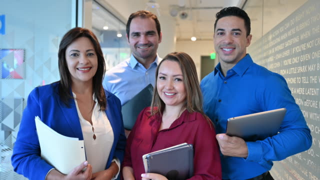 portrait of hispanic business team in hallway - side by side stock videos & royalty-free footage