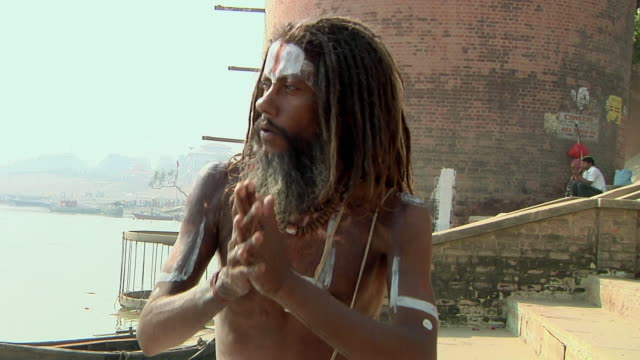 MS Portrait of holy man by river Ganges / Varanasi, Uttar Pradesh, India