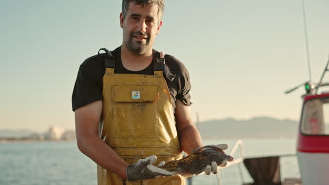 portrait of independent fisherman showing fresh catch - fisherman stock videos & royalty-free footage
