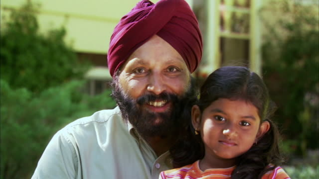 cu zi portrait of indian man with granddaughter (6-7), halifax, nova scotia, canada - see other clips from this shoot 1464 stock videos and b-roll footage