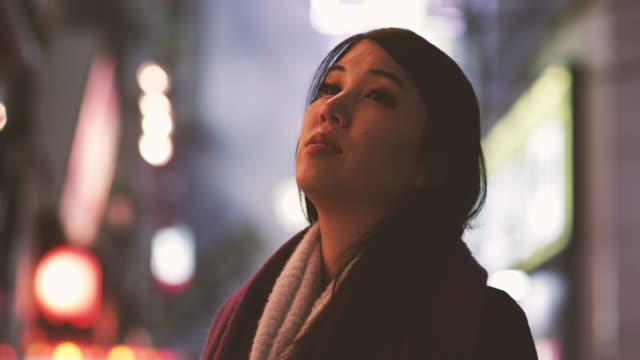 portrait of japanese female on street in shinjuku at night, tokyo, japan - one night stand stock videos & royalty-free footage