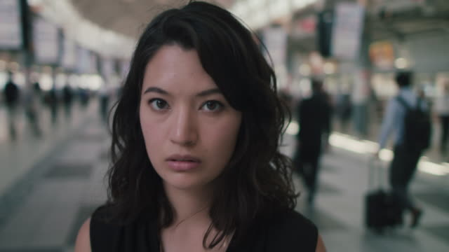 portrait of japanese woman walking in train station in tokyo, japan - japanese ethnicity stock videos & royalty-free footage