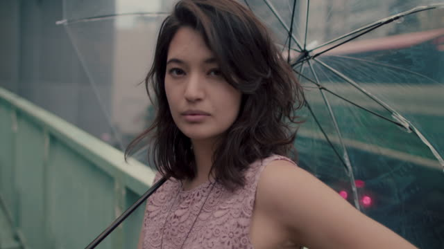 portrait of japanese woman with umbrella / tokyo, japan - black hair stock videos & royalty-free footage
