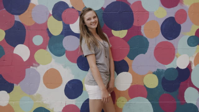 portrait of laughing girl posing near dotted wall / provo, utah, united states - provo stock videos & royalty-free footage