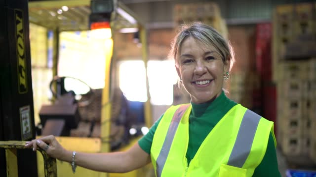 portrait of leader woman at warehouse - forklift stock videos & royalty-free footage