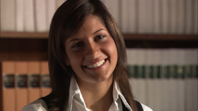 portrait of legal intern smiling at camera in law library / rome, italy - lawyer stock videos & royalty-free footage