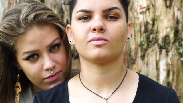 portrait of lesbian couple at park - piercing stock videos & royalty-free footage
