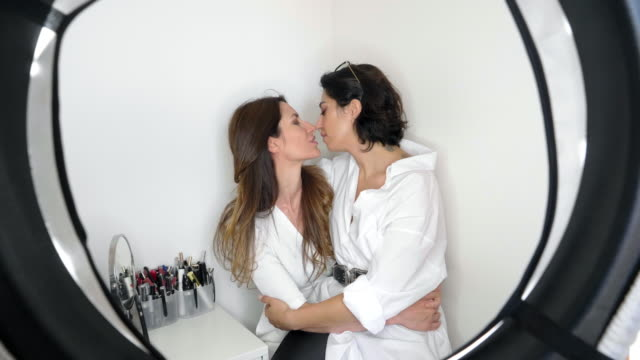 portrait of lesbian couple smiling and kissing - mid length hair stock videos & royalty-free footage