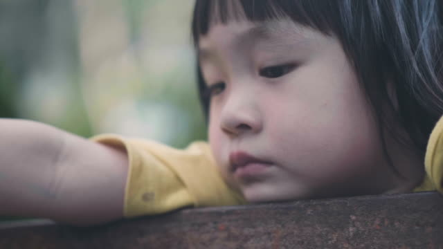 portrait of little baby girl sadness - chinese ethnicity stock videos & royalty-free footage