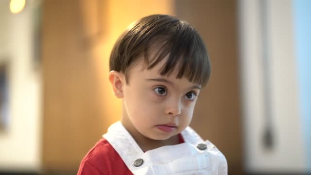 portrait of little boy with special needs - down's syndrome stock videos & royalty-free footage