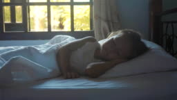 Portrait of little cute girl sleeping in the bed at morning