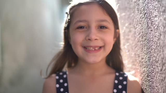 portrait of little cute girl smiling at home - brown hair stock videos & royalty-free footage