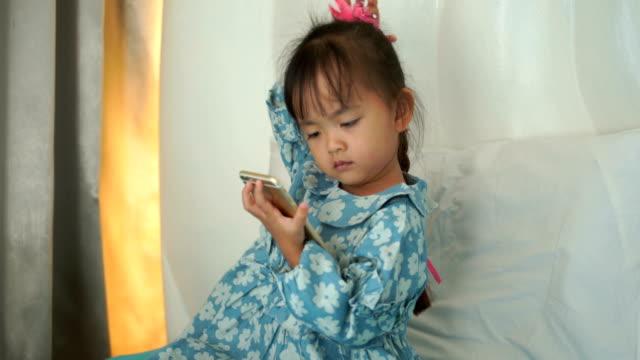 portrait of little girl looking his tablet - pardo brazilian stock videos & royalty-free footage