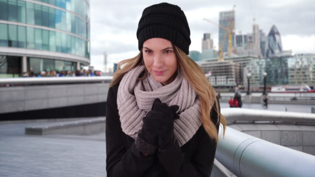 Portrait of London woman shiver in the cold downtown