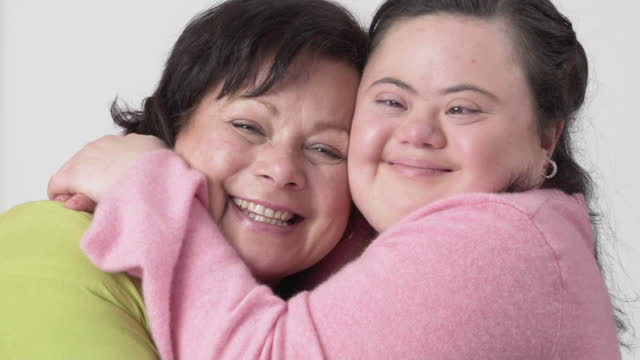 portrait of loving mother and daughter - disability stock videos & royalty-free footage