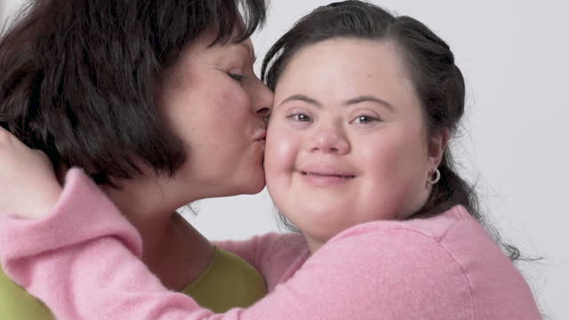 portrait of loving mother and daughter - sindrome di down video stock e b–roll