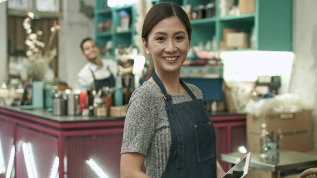 portrait of malay chinese woman at her coffee shop - cultura malesiana video stock e b–roll