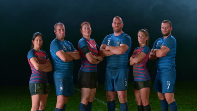 slo mo portrait of male and female rugby players standing in the playing field - sports team stock videos & royalty-free footage