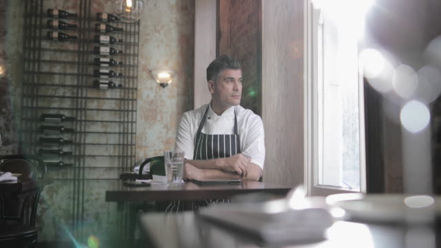 portrait of male chef in restaurant - chef stock videos & royalty-free footage